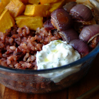 Brown Rice with Roasted Squash and Onions, with Herby Yogurt Dressing